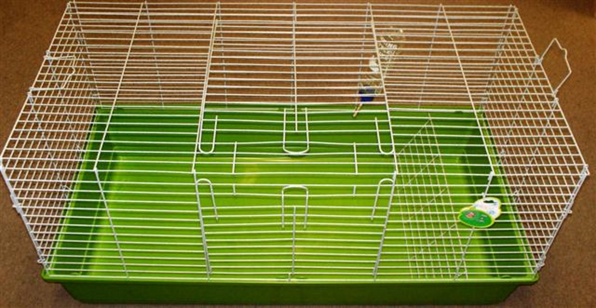 LARGE WIRE CAGE WITH PLASTIC BASE FOR SMALL ANIMALS.
